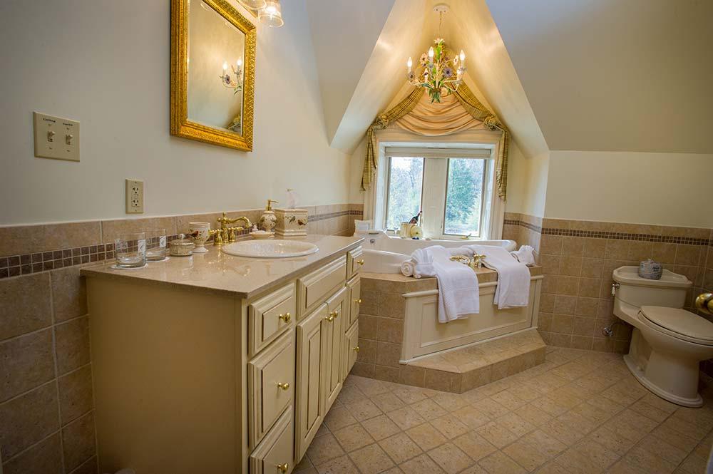 Tiled Bathroom with corner jacuzzi tub