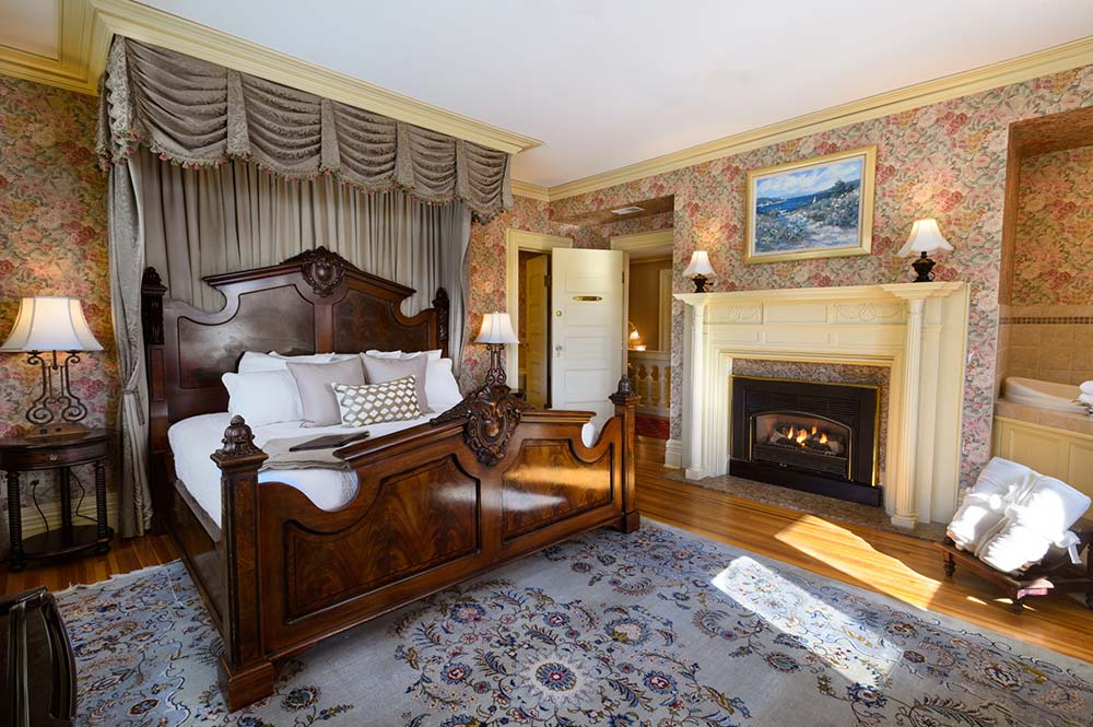 bedroom with fireplace and king bed