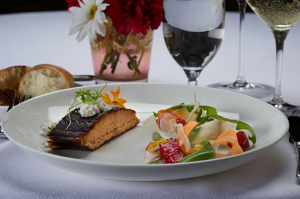 salmon and side salad on plate