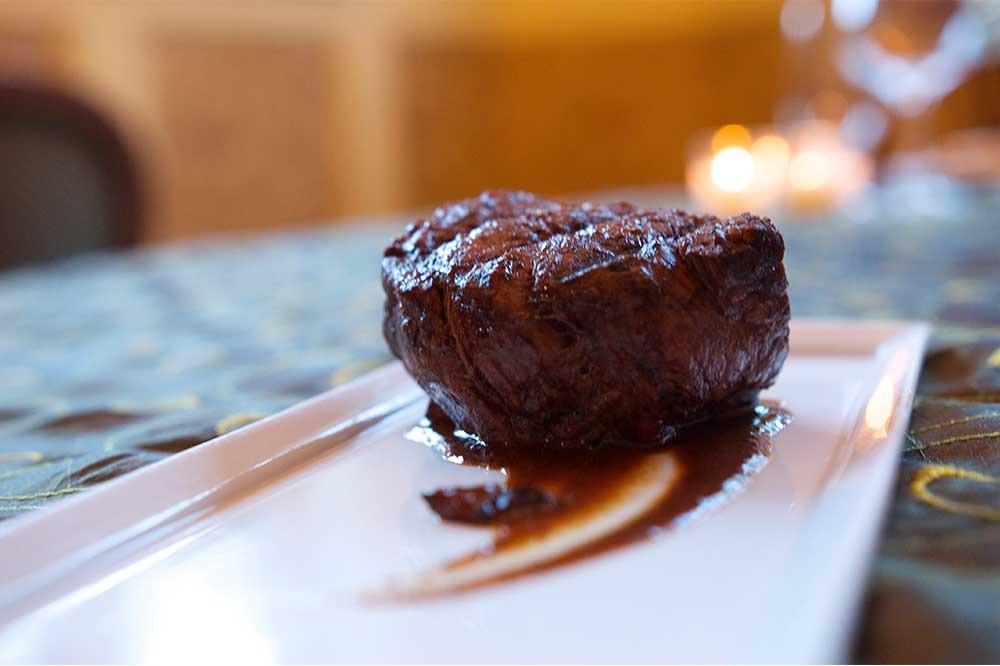close up steak on plate