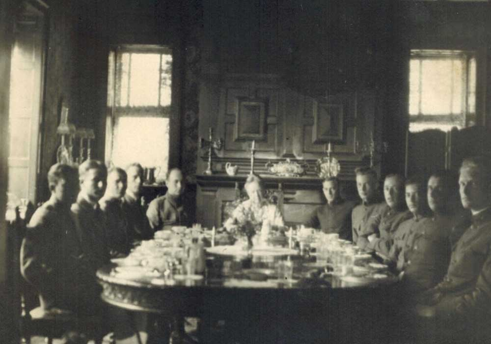 History photo of group at dining table