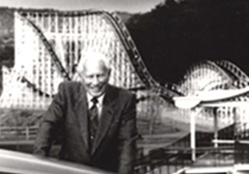 Charlie Wood w in front of rolling coaster