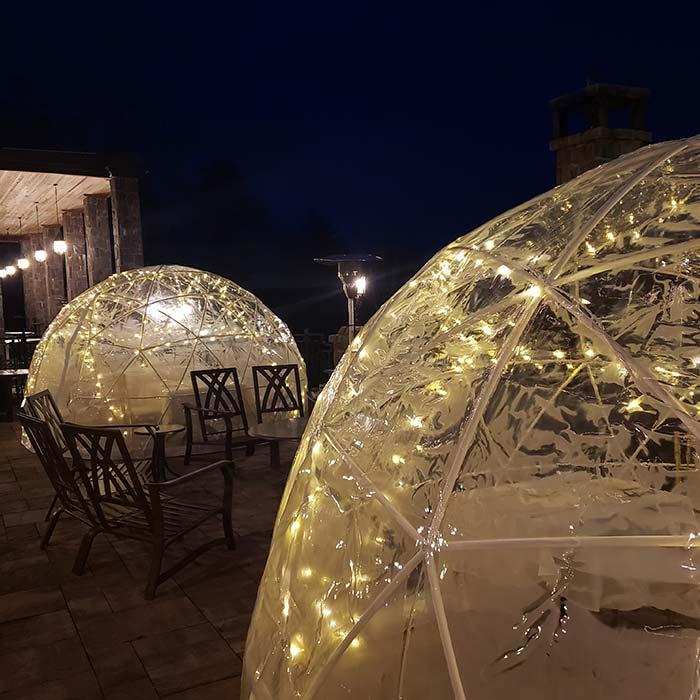 Dining igloos on patio at night