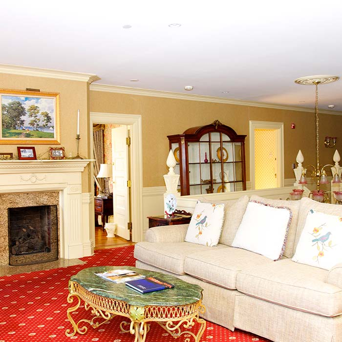 lounge with fireplace and white couch