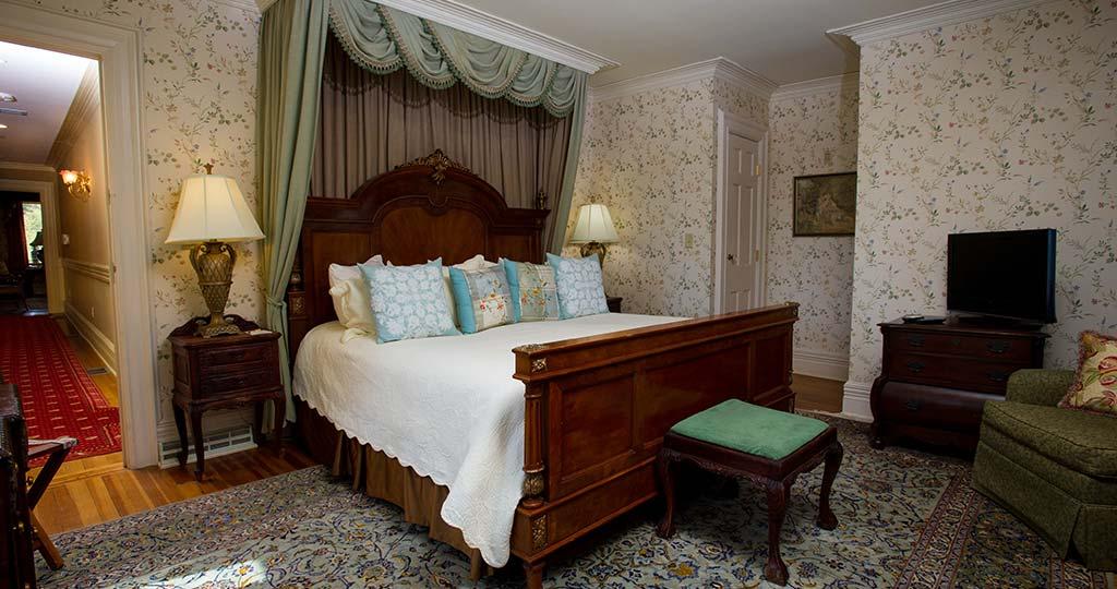 Bedroom with queen wood framed bed