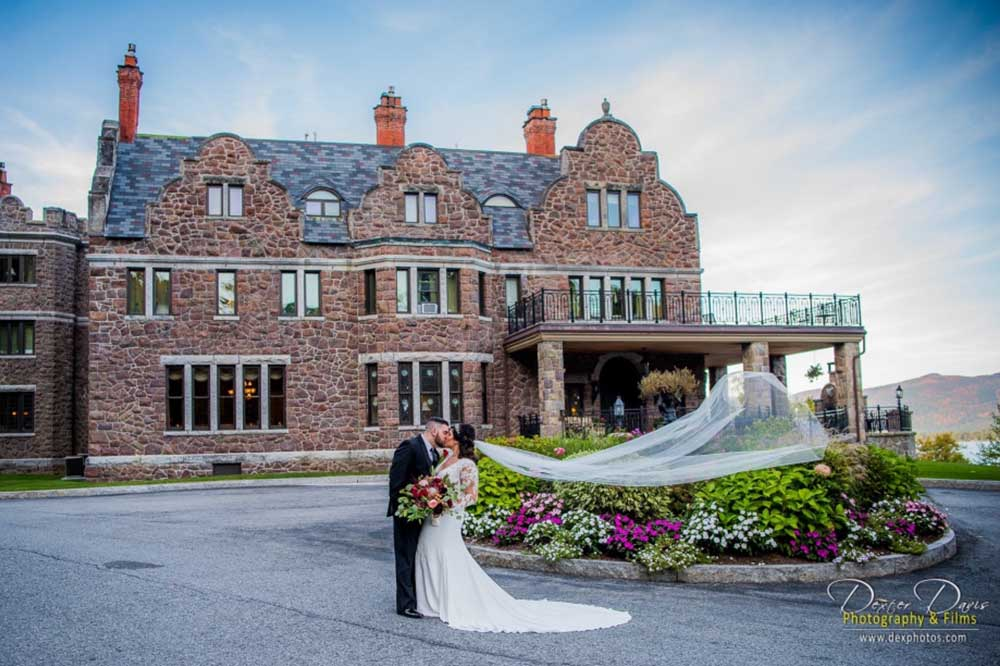 Bride and Groom kissing in front of building