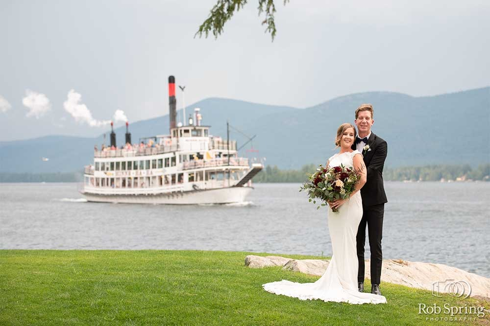 Wedding Bride and groom with Cruise ship behind on lake