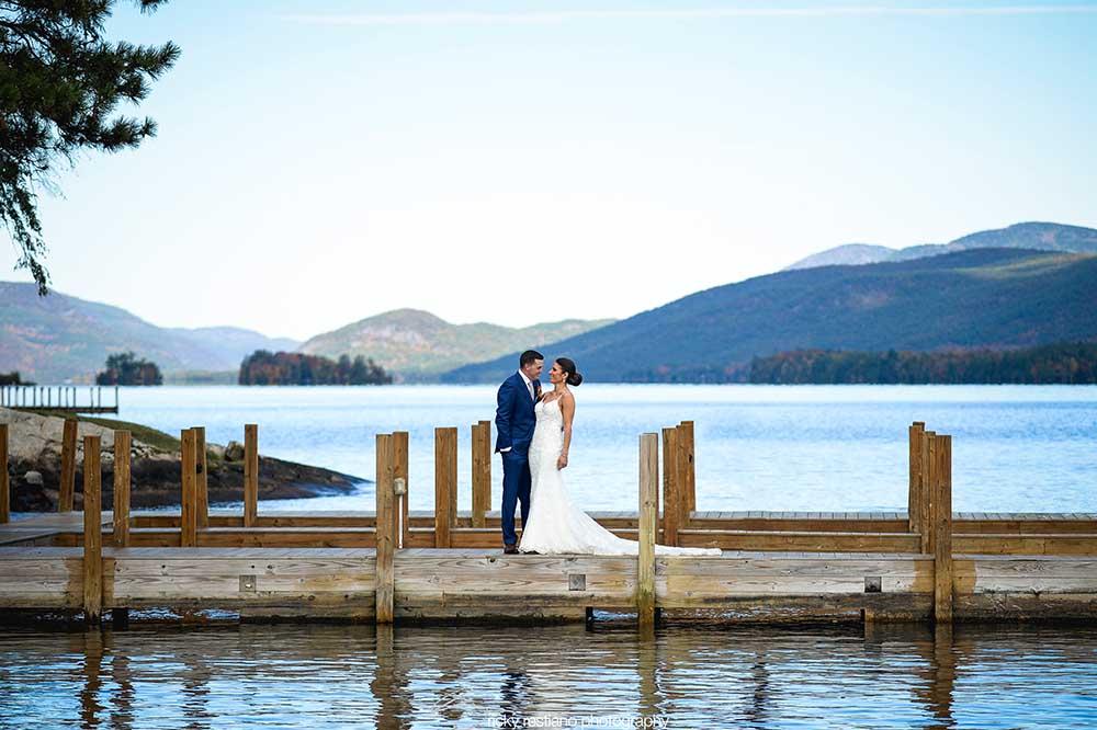 Wedding couple on dock on lake