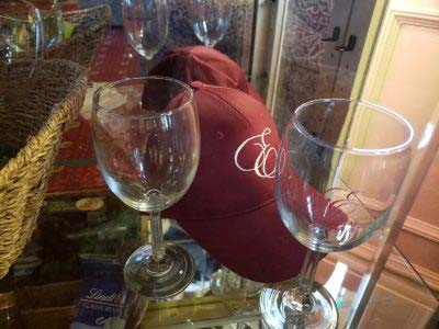 Wine glasses and red hat