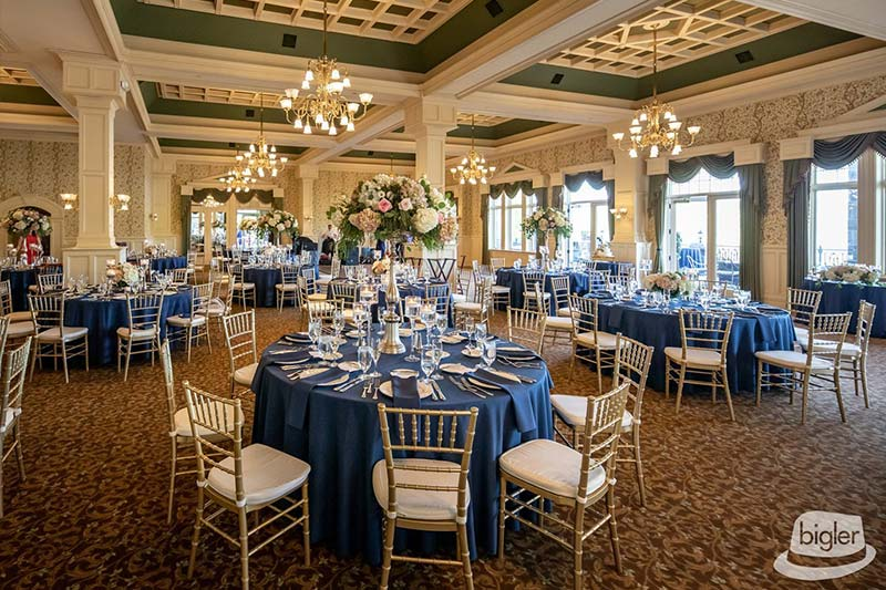 Wedding dining tables with blue tablecloths