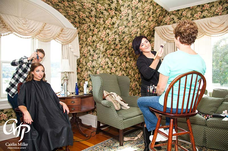 Mother and Daughter getting makeup an hair done before wedding