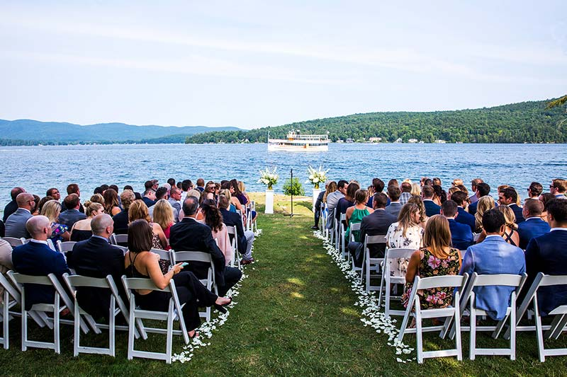 Wedding Ceremony with tour boat in background on lake george