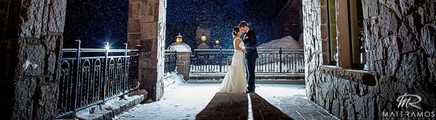 Bride and Groom on patio under falling snow